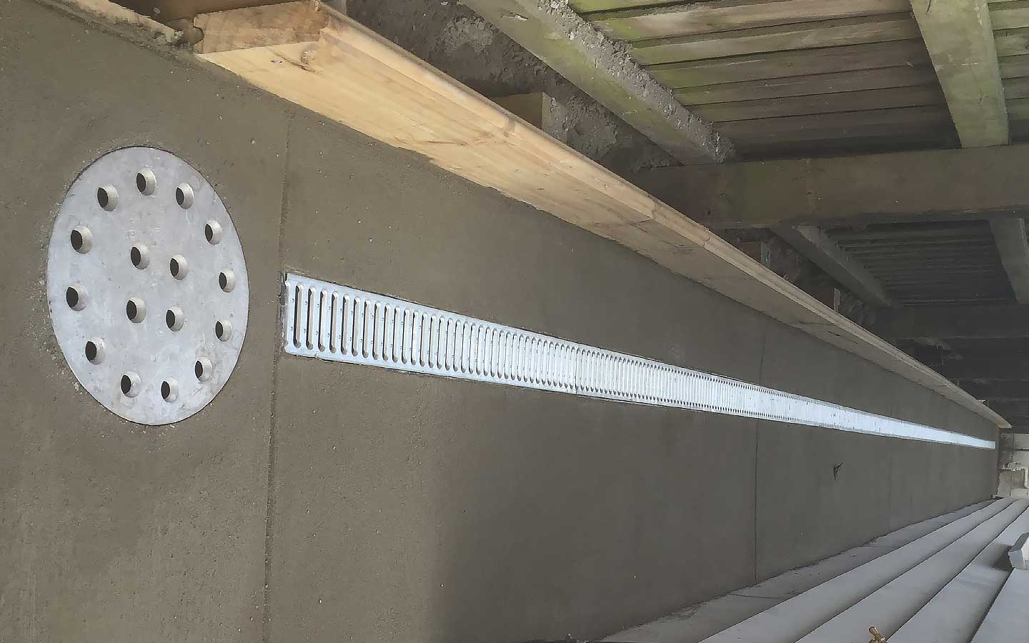 An outdoor drainage system for building code compliance.